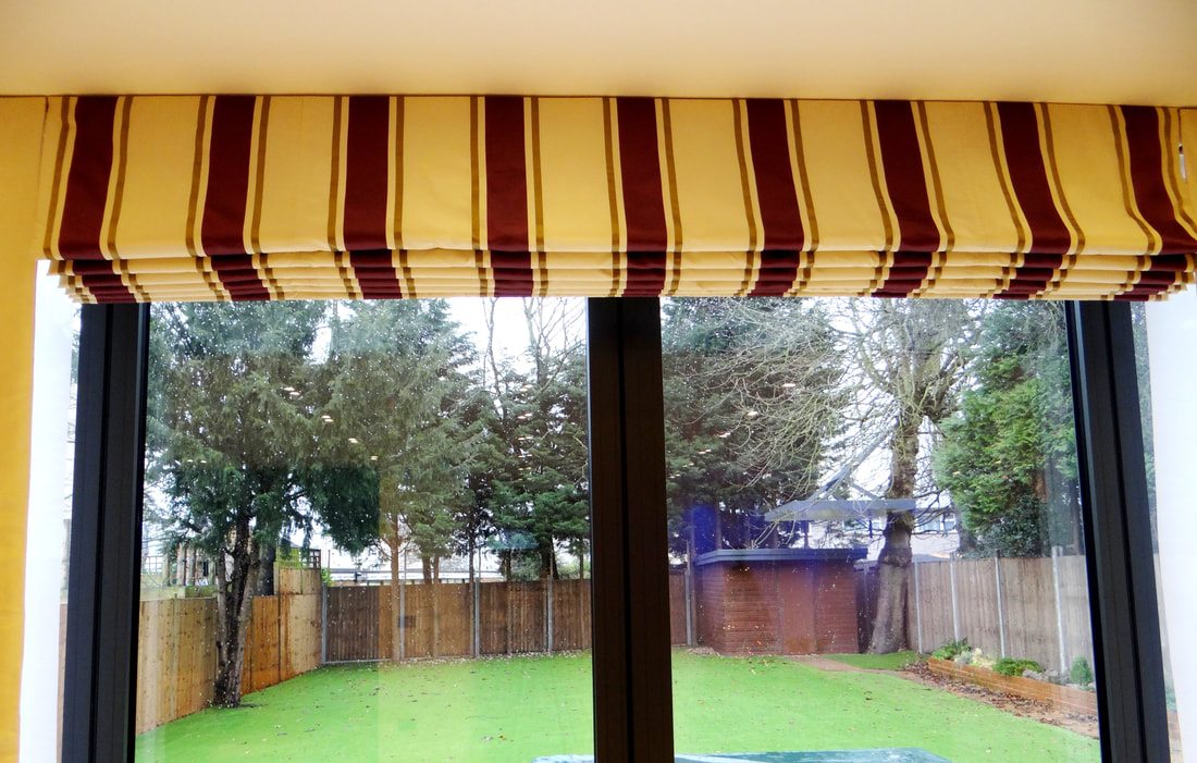 Roman blinds are made from fabric, offering a similar feel to curtains